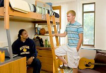 Students talking in a dorm room