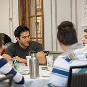 students discussing at a table